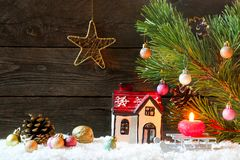 Christmas holiday background with a house in the snow, Christmas royalty free stock photography