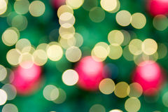 Christmas holiday background over festive bokeh Royalty Free Stock Photo