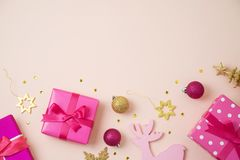 Christmas holiday background with pink gift boxes and decoration royalty free stock image