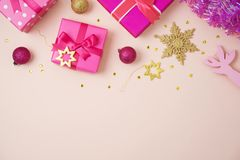 Christmas holiday background with pink gift boxes and decoration royalty free stock photos