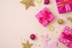 Christmas holiday background with pink gift boxes and decoration royalty free stock images