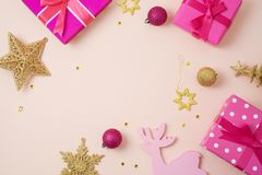 Christmas holiday background with pink gift boxes and decoration stock photo