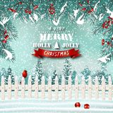 Christmas holiday background with pocket fence, cardinal and spruce branches stock images