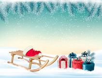 Christmas holiday background with presents and a sleigh. Stock Photography