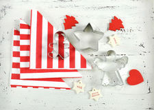 Christmas Holiday background with red and white theme cookie cutters on white wood. Royalty Free Stock Image