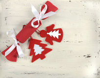 Christmas Holiday background with red and white theme handmade fabric bon-bon cracker with felt decorations on vintage shabby chic Royalty Free Stock Image