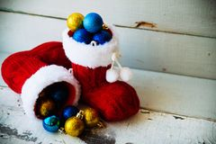 Christmas holiday background with Santa boots and decorations. Retro filter effect Stock Image