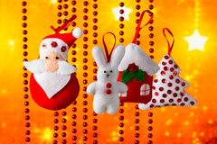 Christmas holiday background with Santa Claus, bunny, house, spruce, decorations and toy. Christmas holiday background with Santa Claus, bunny, house, fir-tree Stock Image
