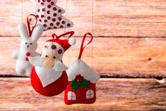 Christmas holiday background with Santa Claus, bunny, house, spruce, decorations and toys. Christmas decoration, holidays, new year and decor card. New Year's Stock Image
