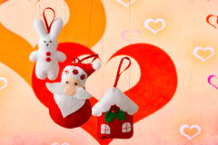 Christmas holiday background with Santa Claus, bunny, house, spruce, decorations and toys. Christmas decoration, holidays, new year and decor card. New Year's Royalty Free Stock Image