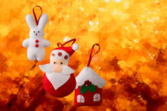 Christmas holiday background with Santa Claus, bunny, house, spruce, decorations and toys. Christmas decoration, holidays, new year and decor card. New Year's Stock Photo