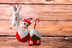 Christmas holiday background with Santa Claus, bunny, house, spruce, decorations and toys. Christmas decoration, holidays, new year and decor card. New Year's Stock Photos