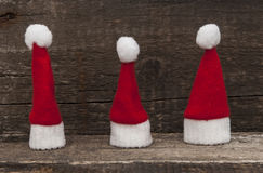 Christmas holiday background with Santa hat and decorations. Stock Photos
