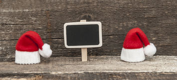 Christmas holiday background with Santa hat and decorations. Royalty Free Stock Photography