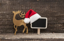 Christmas holiday background with Santa hat and decorations. Royalty Free Stock Photo