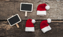 Christmas holiday background with Santa hat and decorations. Stock Photo