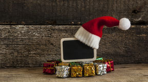 Christmas holiday background with Santa hat and decorations. Royalty Free Stock Images