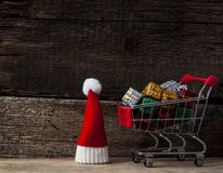 Christmas holiday background with Santa hat and decorations. Royalty Free Stock Photos