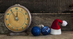 Christmas holiday background with Santa hat and decorations. Royalty Free Stock Image