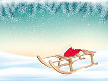 Christmas holiday background with Santa hat and a sleigh. Royalty Free Stock Photos
