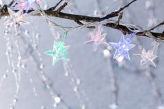 Christmas holiday background with star shaped lights Royalty Free Stock Photo