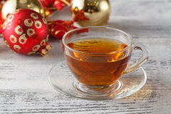 Christmas holiday background with tea cup, pine corn and ornamen Royalty Free Stock Images