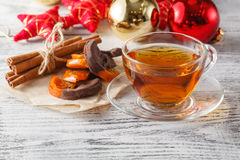 Christmas holiday background with tea cup, pine corn and ornamen Stock Photo