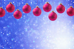 Christmas holiday balls hanging over blue boke background with copy space Royalty Free Stock Photos