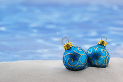 Christmas holiday baubles on the beach Stock Image