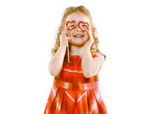 Christmas, holiday, birthday and people concept - funny little girl Stock Photography