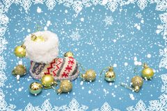 Christmas holiday and celebration background. Boots and decoration balls on blue background with snowflakes. Winter snowfall Royalty Free Stock Image