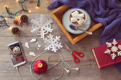 Christmas holiday celebration. Preparing paper snowflakes. View from above. Stock Photography