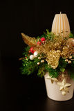 Christmas holiday centerpiece decor with fir branches, golden le Stock Photos