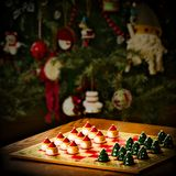 Christmas holiday checker board game and tree decorations royalty free stock photo
