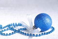 Christmas or holiday composition with blue silver balls on billowy feathers with snow and snowflakes. Christmas or holiday composition with blue silver balls on stock photography