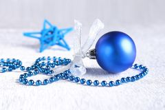 Christmas or holiday composition with blue silver balls on billowy feathers with snow and snowflakes. Christmas or holiday composition with blue silver balls on royalty free stock photography