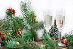 Christmas holiday composition, champaign, pine branches, red berries, golden balls. Christmas and New Year seasonal composition with pine tree branches, two stock photos