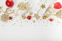 Christmas holiday composition. Festive creative golden pattern, xmas gold decor holiday ball with ribbon, snowflakes, christmas tr royalty free stock photos