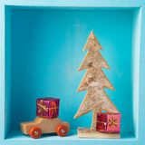 Christmas holiday composition with pine tree, toy car and small. Gift boxes decoration on wooden shelf royalty free stock image