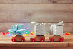 Christmas holiday concept with gift boxes on toy cars. Christmas holiday concept with gift boxes on wooden toy cars royalty free stock photo