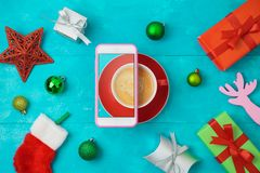 Christmas holiday creative concept with coffee cup, smart phone stock image