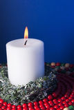 Christmas Holiday Decoration with a Burning Candle Stock Photography