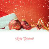 Christmas holiday decorations over red background with white copy space Stock Photos