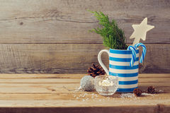 Christmas holiday decorations over wooden background Royalty Free Stock Photo