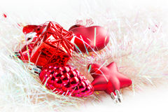 Christmas holiday decorations, red heart, pine cone, bell, gift on white Royalty Free Stock Photo