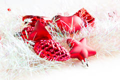 Christmas holiday decorations, red heart, pine cone, bell, gift Royalty Free Stock Photo