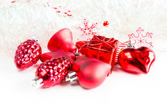 Christmas holiday decorations, red heart, pine cone, bell, gift on white background Royalty Free Stock Photos