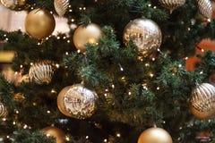 Christmas holiday decorative golden ball pine tree decoration Royalty Free Stock Photos