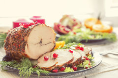 Christmas holiday dinner. Stuffed chicken breast. With herbs, tomatoes, pomegranate and spices against holiday  background. Coloring and processing photo Royalty Free Stock Photo