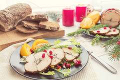 Christmas holiday dinner. Stuffed chicken breast. With herbs, tomatoes, pomegranate and spices against holiday  background. Coloring and processing photo Stock Photo